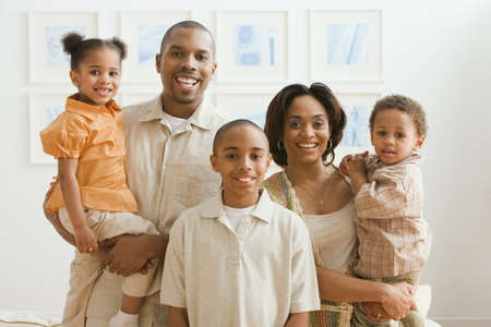 african american couple: Portrait of African family indoors
