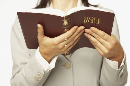 catholicism: Hispanic woman reading Bible