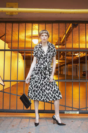 Woman standing in front of parking garage Stock Photo - 16094515