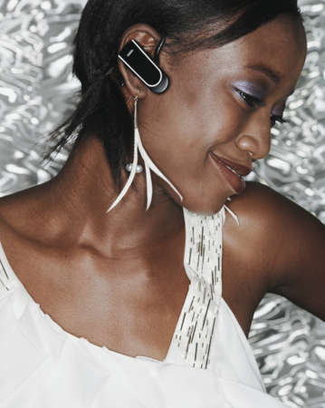 hands free device: African woman wearing hands free device