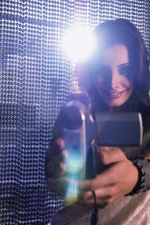 middle eastern woman: Middle Eastern woman using video camera LANG_EVOIMAGES