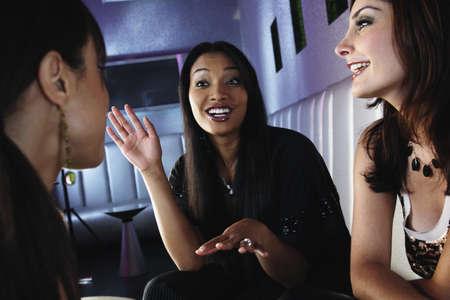 bar: Multi-ethnic women talking at bar