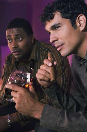 suave: Portrait of two men holding drinks LANG_EVOIMAGES