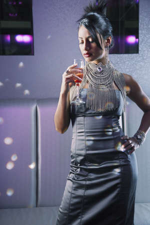 Portrait of Hispanic woman wearing evening gown Stock Photo - 16094591