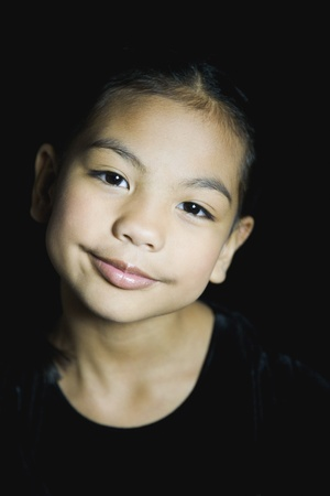 pacific islander: Close up of Pacific Islander girl smiling LANG_EVOIMAGES