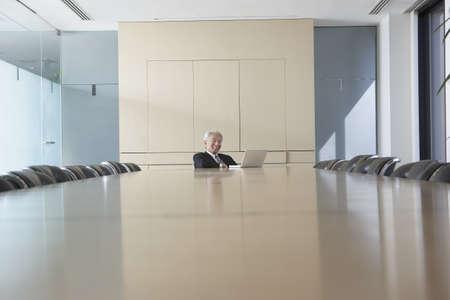 babyboomer: Senior Asian businessman at conference table