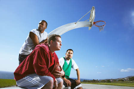 3 persons only: Multi-ethnic men on basketball court