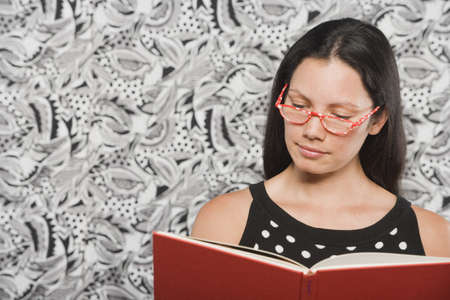 mixed race woman: Young woman reading book