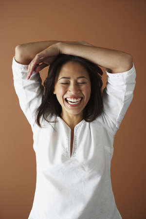 relishing: Asian woman laughing
