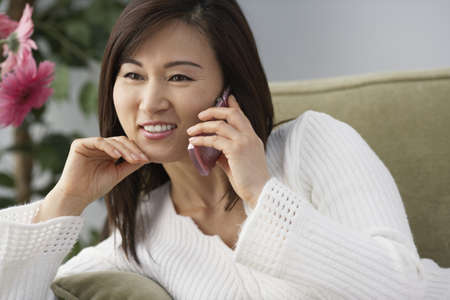 acknowledging: Asian woman talking on cell phone