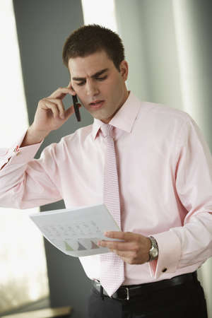 Middle Eastern businessman looking at paperwork Stock Photo
