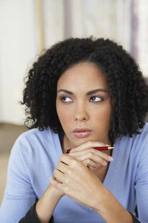 impassive: African businesswoman thinking