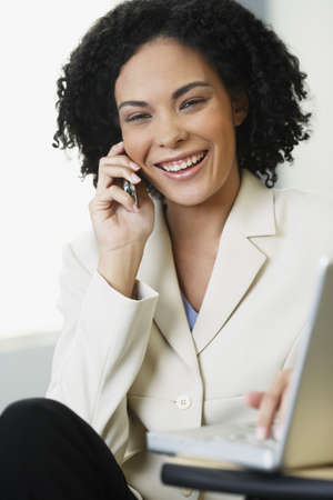 african american woman business: African businesswoman talking on cell phone