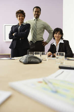 Multi-ethnic businesspeople at conference table Stock Photo - 16094766