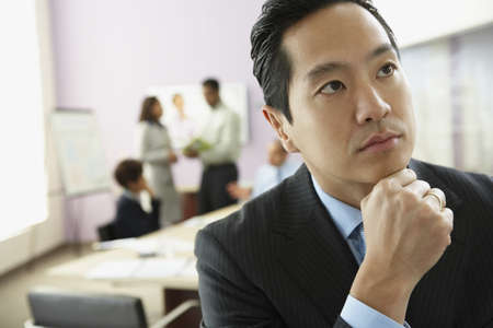 spectating: Asian businessman thinking LANG_EVOIMAGES