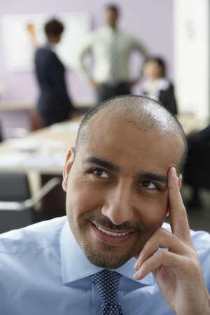 visualizing: Middle Eastern businessman thinking LANG_EVOIMAGES