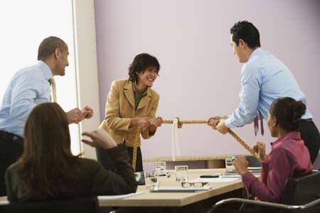 Businesspeople playing tug of war Stock Photo - 16094780