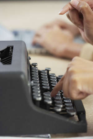 Businesswoman typing on typewriter Stock Photo - 16094782