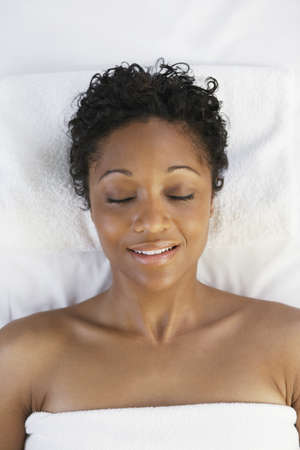 African woman laying on spa table Stock Photo - 16094786