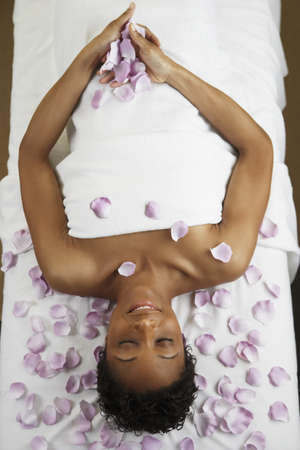 african american spa: African woman laying on spa table