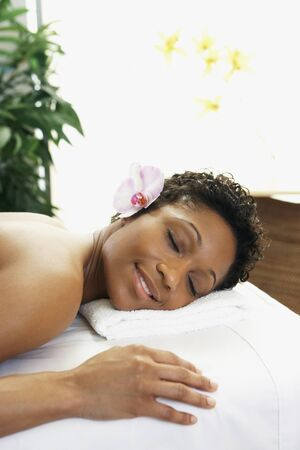 relishing: African woman laying on spa table