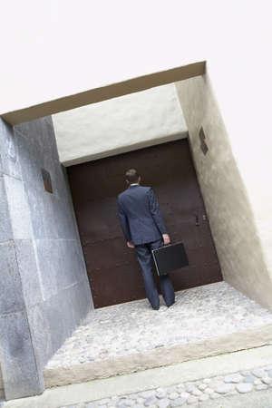 Hispanic businessman standing at doorway Stock Photo - 16094794