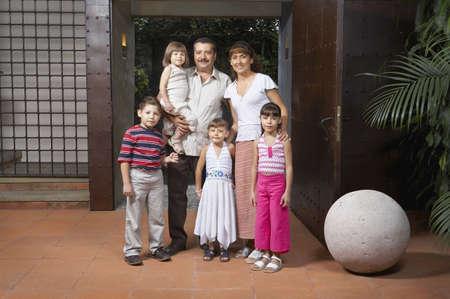 Hispanic family in doorway Stock Photo - 16094805