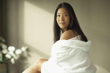 bathtowel: Asian woman wrapped in towel