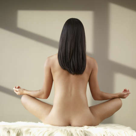20's nude: Rear view of nude Asian woman meditating
