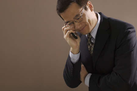 Asian businessman talking on cell phone Stock Photo - 16094821