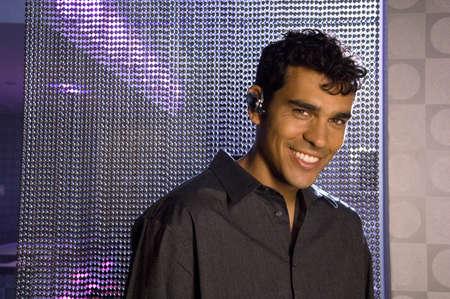 suave: Portrait of Hispanic man wearing hands free device