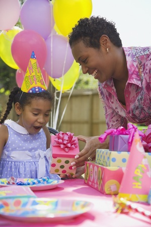 African girl receiving gift at birthday party Stock Photo - 16094856