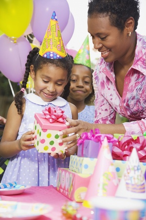 African girl receiving gift at birthday party Stock Photo - 16094857