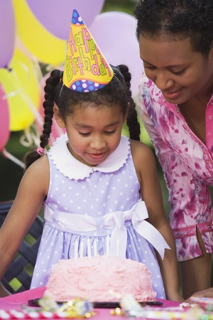 African girl and cake at birthday party Stock Photo - 16094858