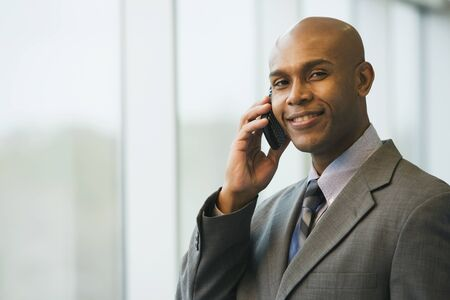 African businessman talking on cell phone Stock Photo - 16094865