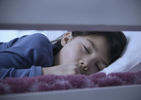 Asian girl sleeping in bed