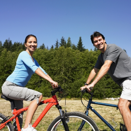Couple on bicycles in rural area Stock Photo - 16094890