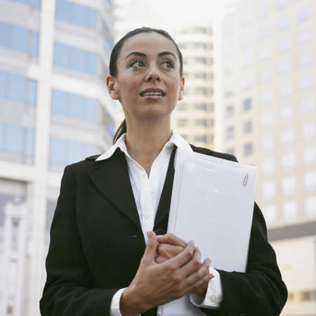 Hispanic businesswoman holding paperwork Stock Photo - 16094894