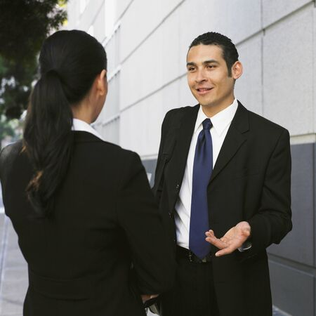 Hispanic businessman talking to coworker Stock Photo - 16094897