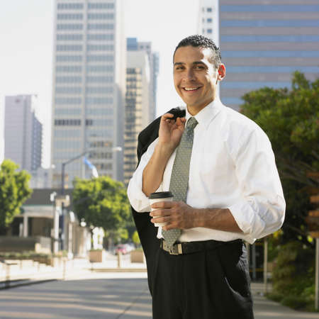 Hispanic businessman holding cup of coffee Stock Photo - 16094900