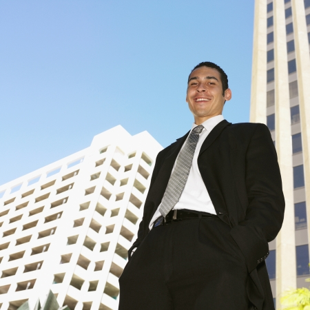Low angle view of Hispanic businessman Stock Photo - 16094902