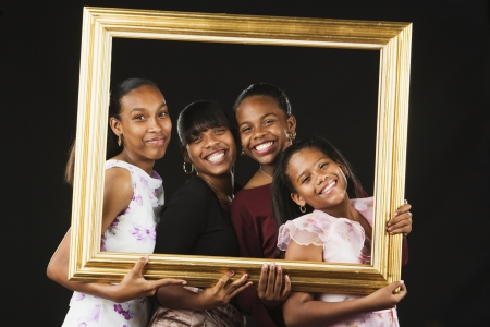 African sisters posing in picture frame Stock Photo - 16094913