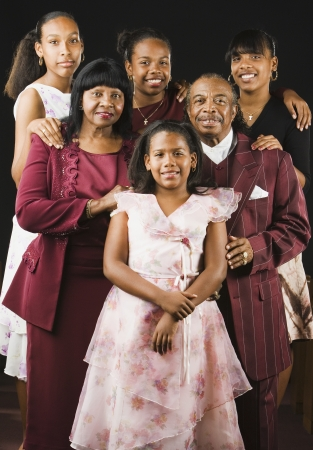 well beings: Portrait of well dressed African family LANG_EVOIMAGES