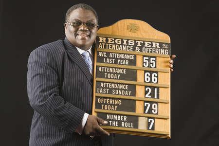 hymn: African man holding hymn board
