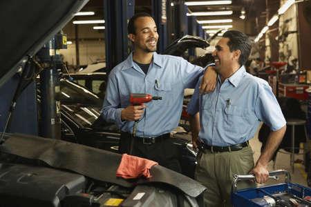 Multi-ethnic male auto mechanics in shop Stock Photo - 16094909