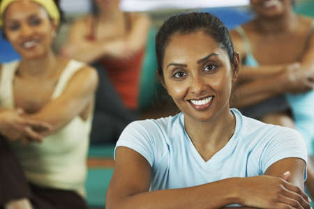 wellness background: Multi-ethnic women in exercise class LANG_EVOIMAGES