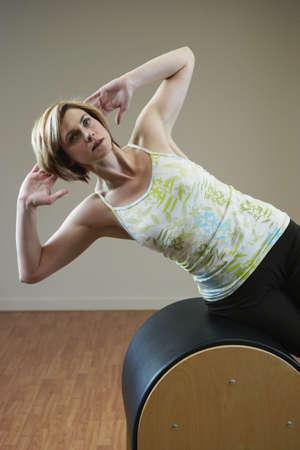 exerting: Woman exercising on equipment