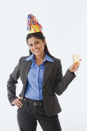 Indian businesswoman wearing party hat Stock Photo - 16094938