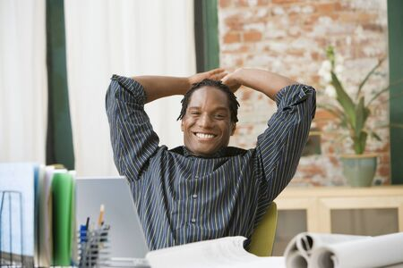 African businessman with hands behind head Stock Photo - 16094957