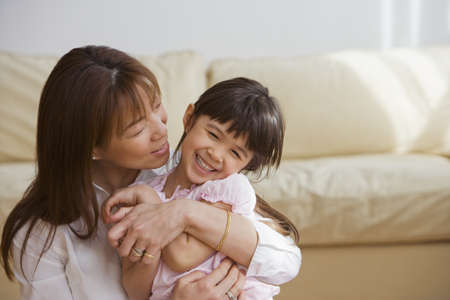 Asian mother and daughter hugging Stock Photo - 16094962